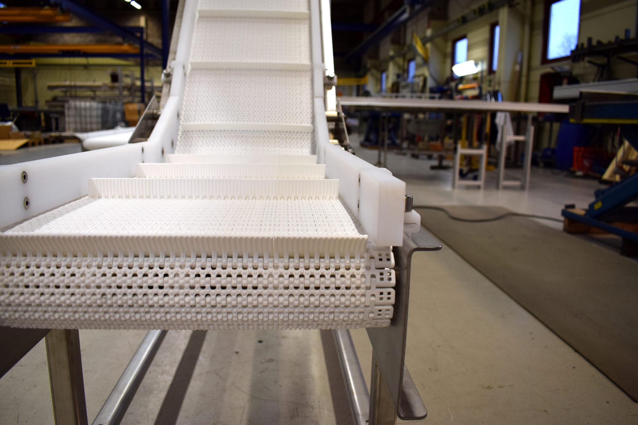 Rostfri bandtransportör med löstagbara sidokanter- Bofab Conveyor AB