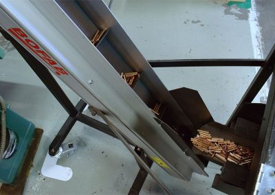 Belt Conveyor for transporting shell casing contructed by Bofab Conveyor for Norma Precision