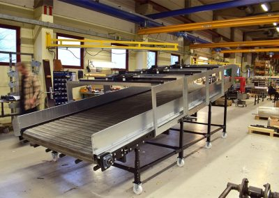 Belt Conveyor with cooling tunnel for plastic tanks and stainless steel belt constructed by Bofab Conveyor AB for american Hyndai